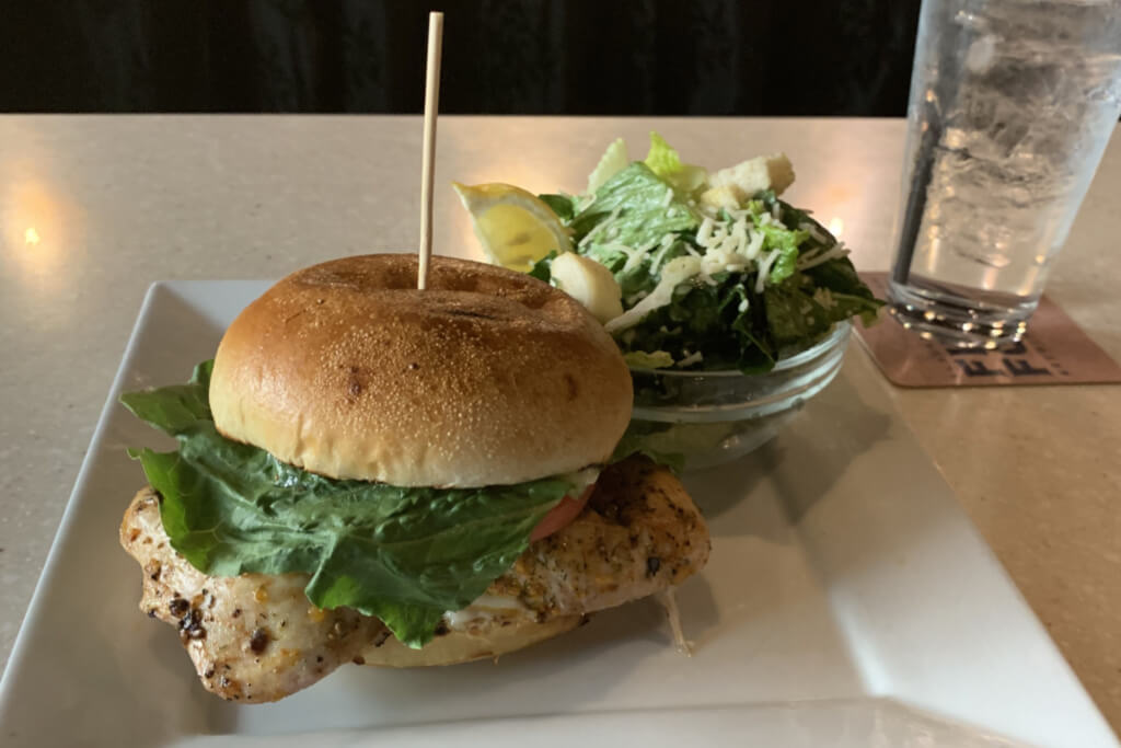chicken sandwich and caesar salad